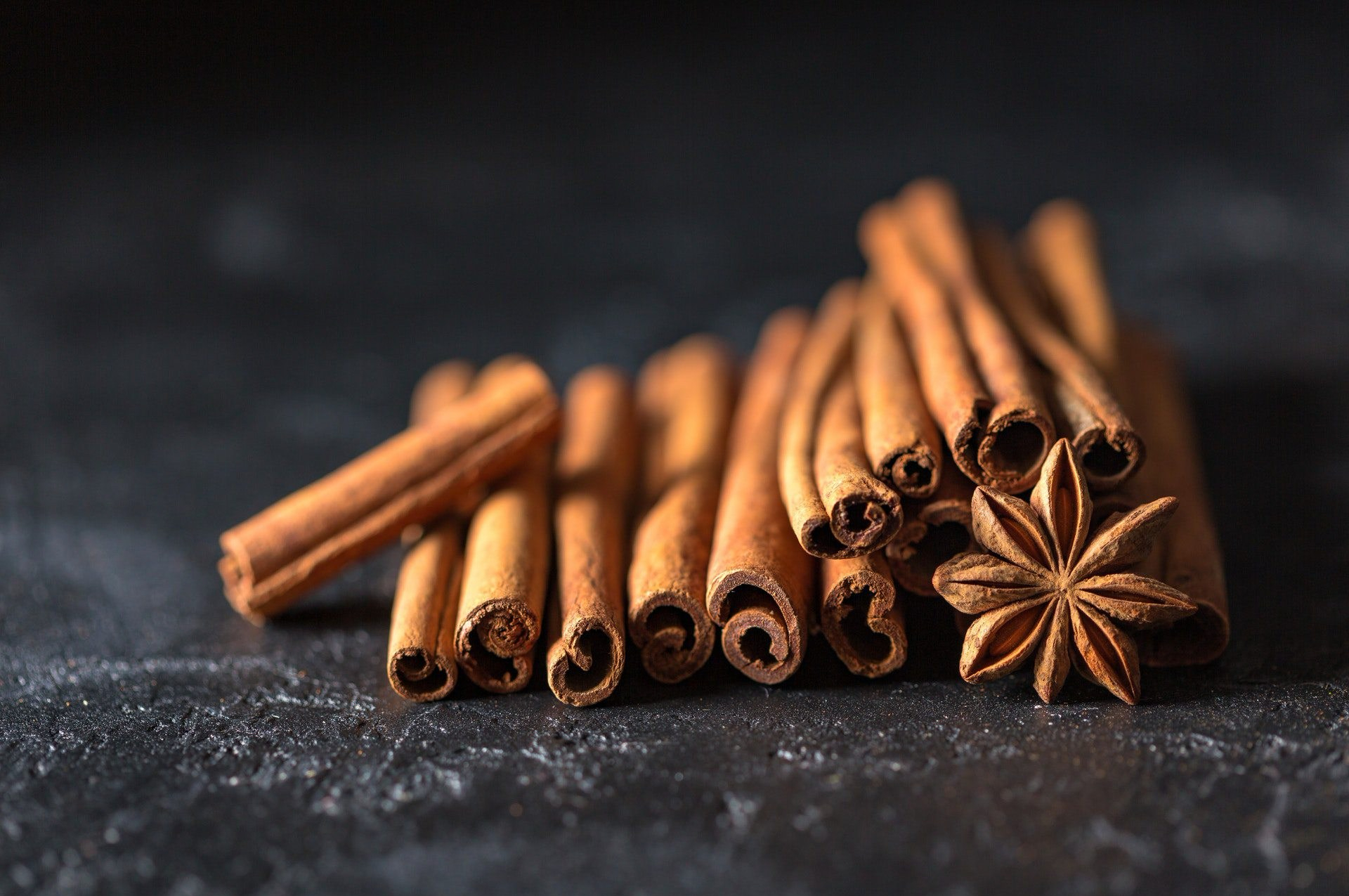 Styled cinnamon stick mound with an aniseed flower
